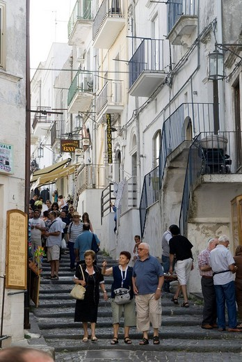 Stock Photo: 1848-30368 People in an alley of the historic town centre, Monte S. Angelo, Apulia, Southern Italy, Italy, Europe