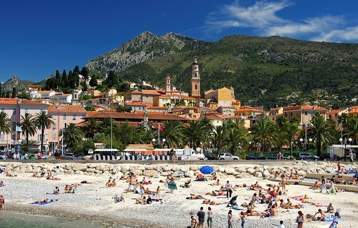 At the beach in Menton, view of the locality and the back_country mountains, Côte d´Azur, France : Stock Photo