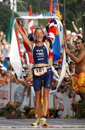 Chrissie Wellington, Great Britain, crossing the finish line of the Ironman Triathlon World Championship as the winner with a new course record of 8:54:02 hours, Kailua_Kona, Hawaii, USA : Stock Photo