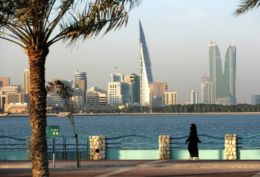 Skyline of the Corniche as seen from King Faisal Highway, Muharraq side, World Trade Center buildings, left, beside the towers of the Financial Harbour Complex, capital city, Manama, Kingdom of Bahrain, Persian Gulf : Stock Photo