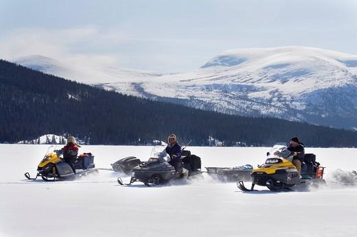 Stock Photo: 1848-32465 Hunters driving snowmobiles or skidoos, Yukon Territory, Canada, North America