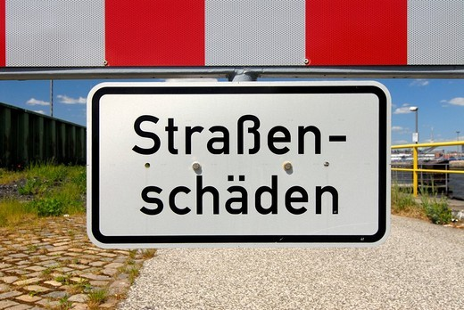Stock Photo: 1848-32615 Sign with the message Stassenschaeden, road damage