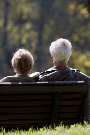 Senior citizens on a park bench : Stock Photo