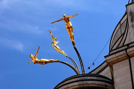 Stock Photo: 1848-33389 Three golden female nude statues diving from a roof above Piccadilly Circus, London, United Kingdom