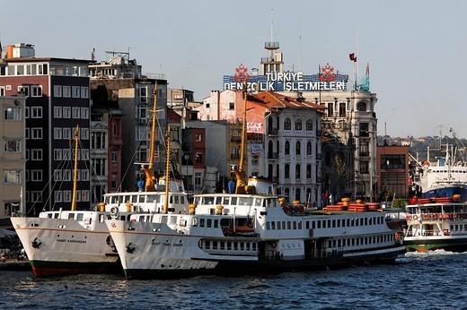 Old ferries at the Karakoey pier, Bosphorus shore, Istanbul, Turkey : Stock Photo