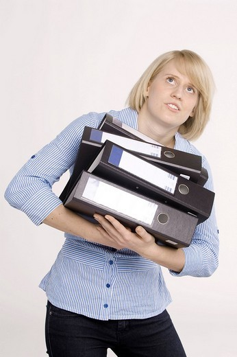 Stock Photo: 1848-34559 Young woman carrying files