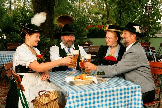 Stock Photo: 1848-34671 People wearing traditional costume in a beer garden, Muehldorf am Inn, Upper Bavaria, Germany, Europe