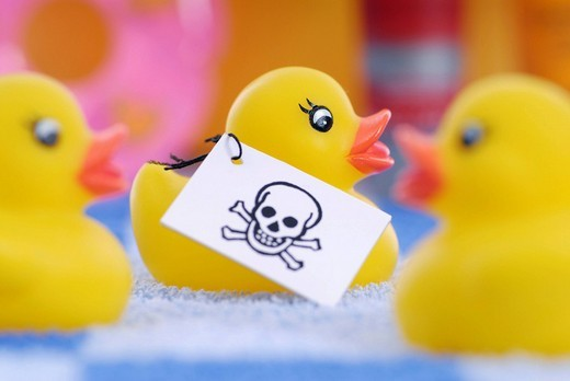 Stock Photo: 1848-35359 Rubber duck with skull_label, poisons in rubber and plastic products