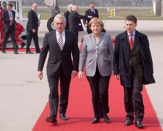 Heribert Rech, interior minister of Baden_Wuerttemberg, Federal Chancellor Dr. Angela Merkel and Prof. Joachim Sauer, 60 years NATO, the arrival of the delegations at the airport Karlsruhe / Baden_Baden, Baden Airpark, Rheinmuenster, Baden_Wuerttemberg, G : Stock Photo