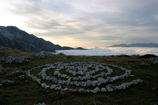 Stone circles, fog and clouds at Prati di Tivo, below Corno Grande, highest mountain of Central Italy. : Stock Photo