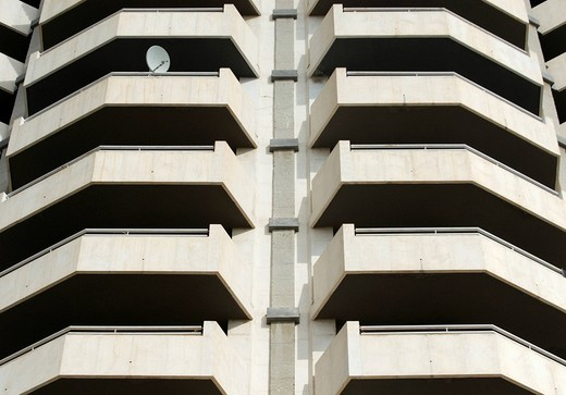 Stock Photo: 1848-38398 Satellite dish mounted to a balcony on a fortress_like high_rise apartment building in Benidorm, Alicante, Spain