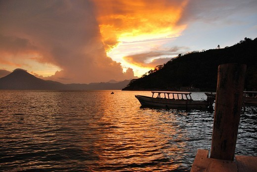 Sunset, back light, dramatic clouds, boat, Lake Atitlán, Guatemala, Central America : Stock Photo