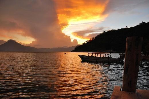 Stock Photo: 1848-38418 Sunset, back light, dramatic clouds, boat, Lake Atitlán, Guatemala, Central America