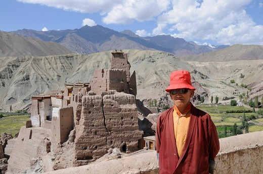 Stock Photo: 1848-39039 Buddhist monk in front of the Basgo castle ruins and monastery in the Indus Valley, Ladakh, India, Himalayas, Asia