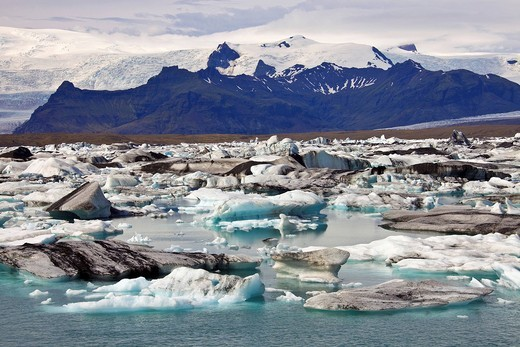Icebergs in the Joekulsarlon glacial lake with different colorations due to volcanic ash, Joekulsárlón, Vatnajoekull, Iceland, Europe : Stock Photo
