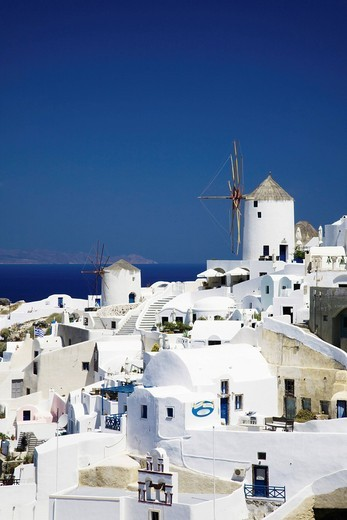 Stock Photo: 1848-401361 Two windmills amongst terraces, Oia, Santorini, Cyclades, Greece, Europe