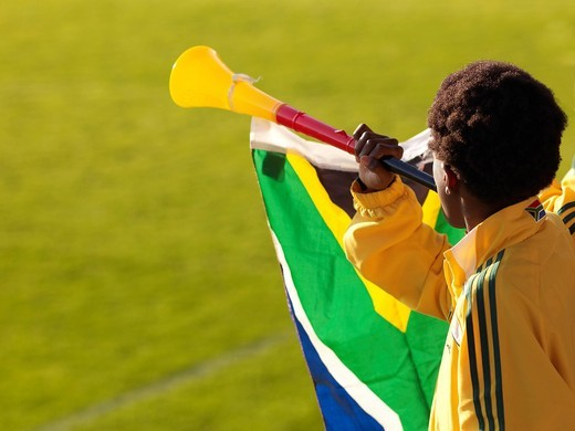 African boy in the jersey of South Africa with a national flag and a vuvuzela : Stock Photo