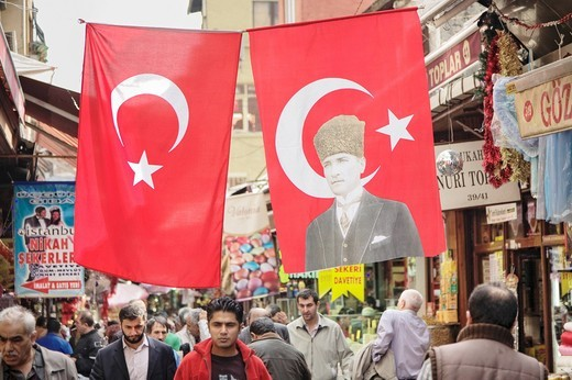 Turkish flag with the imprint of Atatuerk in the narrow streets of the Egyptian Bazaar, Istanbul, Turkey : Stock Photo