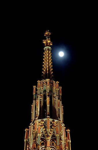 Schoene Brunnen fountain in the shape of a Gothic steeple, lit by the full moon, Nuremberg, Franconia, Bavaria, Europe : Stock Photo