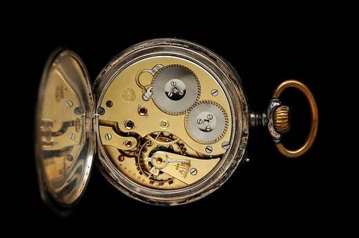 Clockwork mechanism of an antique silver pocket watch from 1097, International Watch Co., Schaffhausen, IWC : Stock Photo