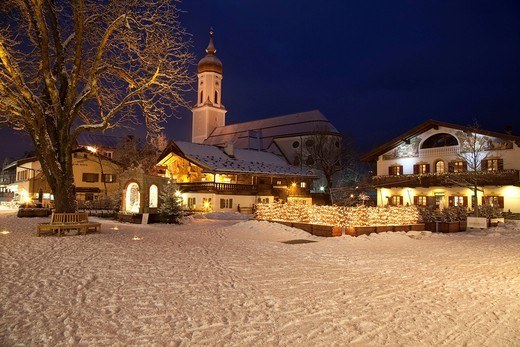 Town view with St. Martin parish church, public library, Mohrenplatz square, snow, blue hour, Garmisch_Partenkirchen, Upper Bavaria, Bavaria, Germany, Europe : Stock Photo