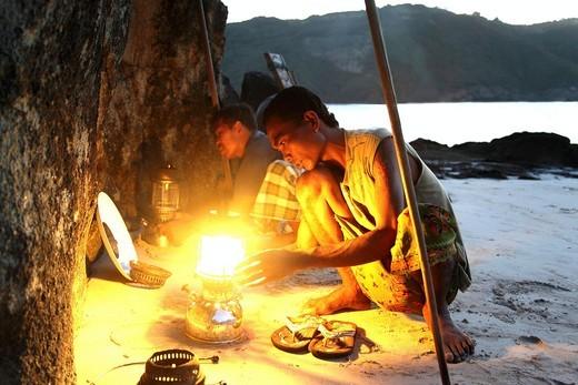 Fishermen lighting lamps, Lombok, Indonesia, Southeast Asia : Stock Photo