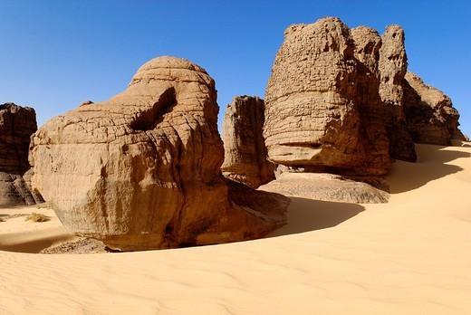 Eroded rock formations in Tin Akachaker, Tassili du Hoggar, Wilaya Tamanrasset, Sahara Desert, Algeria, North Africa : Stock Photo