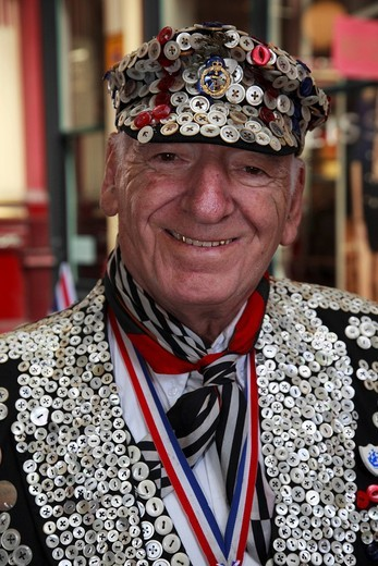 A Pearly King, traditional London character wearing a suit decorated with buttons, Leadenhall Market, City of London, England, United Kingdom, Europe : Stock Photo
