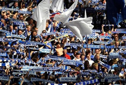 Stock Photo: 1848-404843 Schalke soccer fans standing in the Nordkurve fan block, Gelsenkirchen, North Rhine_Westphalia, Germany, Europe