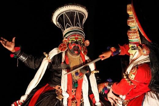 Stock Photo: 1848-406753 Kathakali dance, Pachcha character with sword and Chuvanna Thaadi character, Kerala, southern India, Asia