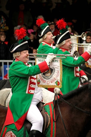 Rider group with fanfares at the Rosenmontagszug parade, Carnival 2010 in Cologne, North Rhine_Westphalia, Germany, Europe : Stock Photo