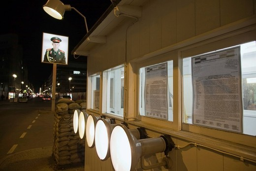 Former border crossing at Checkpoint Charlie with a portrait of a Soviet soldier, Berlin, Germany, Europe : Stock Photo