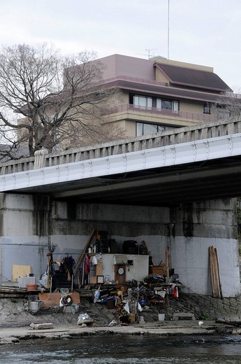 Homeless person under a bridge at the river Kamo in Kyoto, Japan, Asia : Stock Photo
