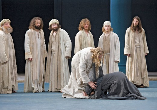 A convicted adulteress, who is to be stoned, falls to her knees in front of Jesus, Passion Play 2010, Oberammergau, Bavaria, Germany, Europe : Stock Photo