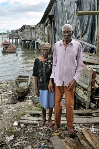 Stock Photo: 1848-408648 Old married couple, Afro_Colombians, in front of their house in the Bajamar slum, Buenaventura, Valle del Cauca, Colombia, South America