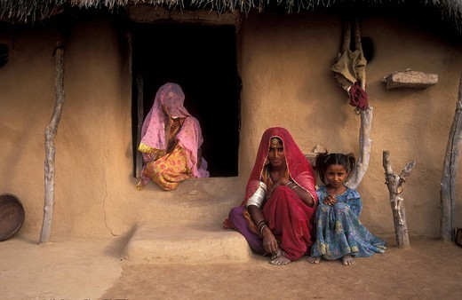 Women sitting in front of a house, Thar Desert, Rajasthan, India, Asia : Stock Photo