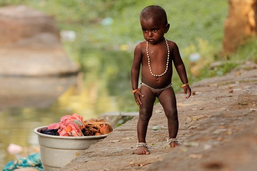 Stock Photo: 1848-411169 Young naked baby, girl with beads next to washing, Tenkasi, Tamil Nadu, Tamilnadu, South India, India, Asia