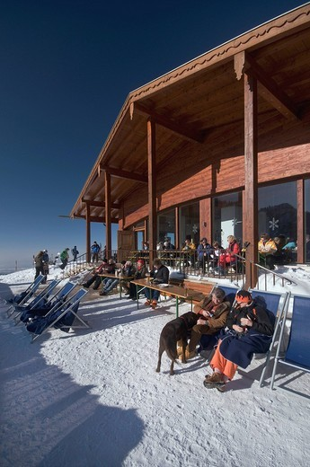 Stock Photo: 1848-411343 Winter visitors on the sun terrace of the Sonnenalm mountain lodge, Chiemgau, Upper Bavaria, Bavaria, Germany, Europe