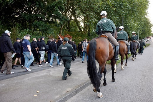 Mounted police at a police operation at a football match, accompanying fans to the stadium, Germany, Europe : Stock Photo