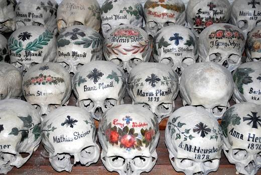 Painted skulls at the churchyard bone house, Catholic church, Hallstatt at the Hallstaetter See, Lake Hallstatt, UNESCO World Heritage Site, Salzkammergut, Alps, Upper Austria, Europe : Stock Photo