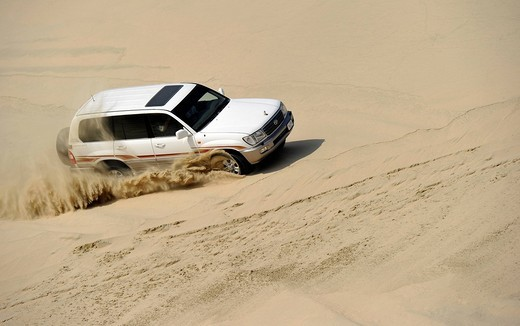 Off_roader Toyota Land Cruiser 4x4, driving in sand dunes, Emirate of Qatar, Persian Gulf, Middle East, Asia : Stock Photo