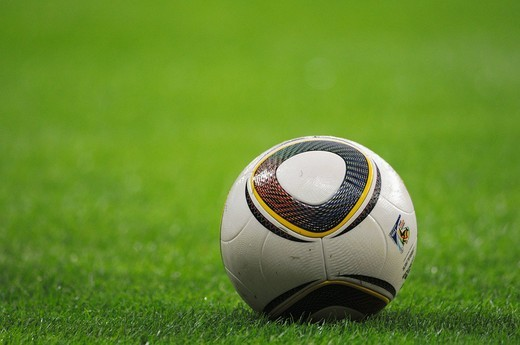 Stock Photo: 1848-416252 Jabulani official match ball of the FIFA 2010 World Cup in South Africa, on a football pitch