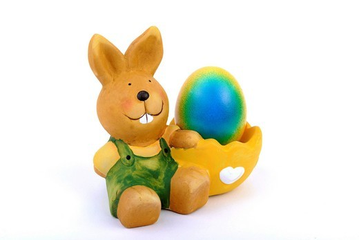 Easter bunny with egg cup and a colorful, dyed Easter egg : Stock Photo