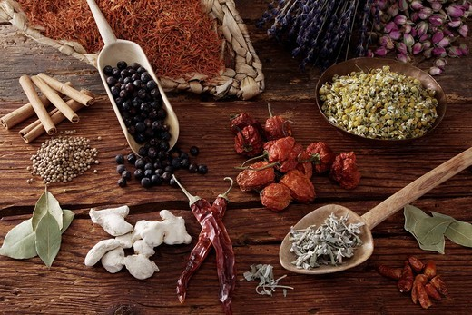 Mixed spices, Safflower Carthamus tinctorius, Lavender Lavandula angustifolia, Rosebuds Rosa, cinnamon, Juniper Juniperus, Mini_Peppers capsicum, Chamomile Matricaria chamomilla, Bay Laurus nobilis, Ginger Zingiber officinale , Sage Salvia officinalis and : Stock Photo