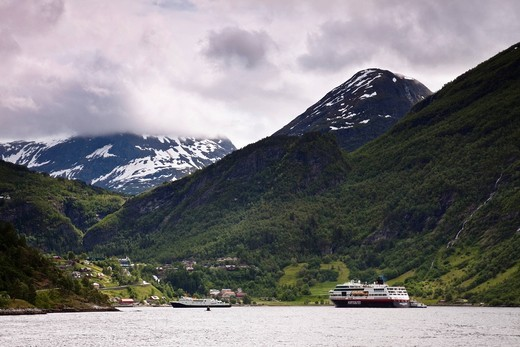 The place Geiranger in Geiranger Fjord with a ship by Hurtigruten, Norway, Scandinavia, Europe : Stock Photo