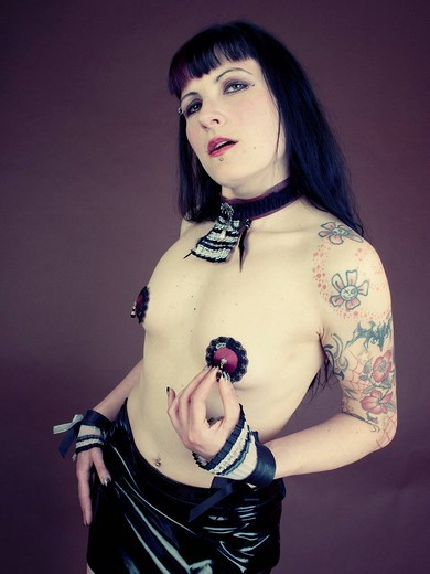 Stock Photo: 1848-417834 Woman, gothic, burlesque, tattooed, serious