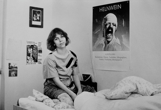 Young woman, student, with poster of Helnwein, Leipzig, Saxony, East Germany, around 1986 : Stock Photo