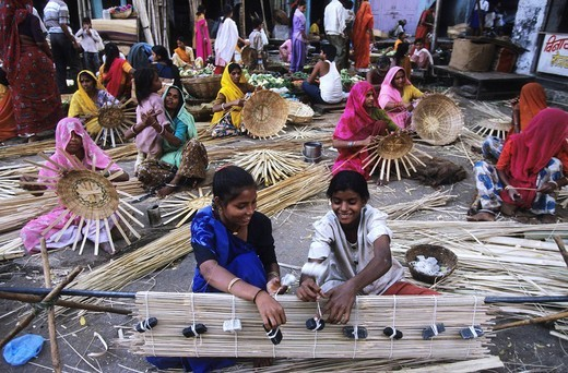 Stock Photo: 1848-41840 Women weaving wickerwork on a market, Udaipur, India