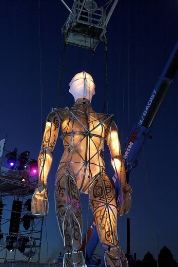 Stock Photo: 1848-418754 Giant illuminated figure on ropes walking through the audience, Global Rheingold, open_air theater by La Fura dels Baus, Duisburg_Ruhrort, Ruhrgebiet area, North Rhine_Westphalia, Germany, Europe