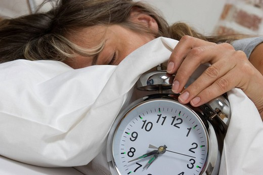 Sleeping woman, alarm clock : Stock Photo